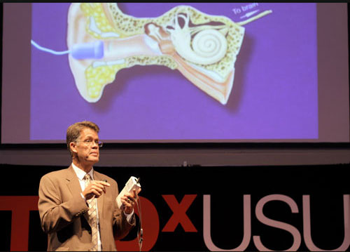 Dr. Karl White at TEDxUSU giving a talk on newborn hearing screening