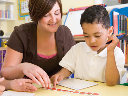 a teacher and child working on math concepts