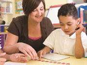 Mathematics Education, a teacher and child working on math concepts