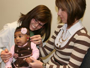 NCHAM, an audiologist testing a baby's hearing