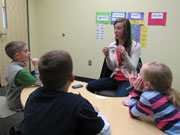 Early Childhood Education, a teacher working on word games with children