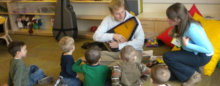 Attentive students participate in a Sound Beginnings music therapy session